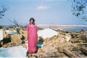 Photo by Holly Michael, Tamilarisa in the remains of her home